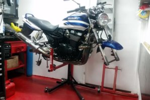 Sky Lift holding stripped down Suzuki GSX1400