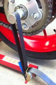 Strap shown fitted around optional Hub Spindle for single sided Swing-Arm machines.